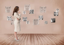 Businesswoman looking at futuristic interface in black and white royalty free stock image