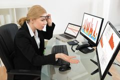 Businesswoman Looking At Graph On Computer Stock Photos