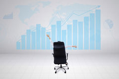 Businesswoman looking at growth graph Stock Image