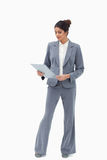 Businesswoman looking at her clipboard Stock Image