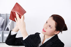 Businesswoman looking at her empty pocket. Royalty Free Stock Photos