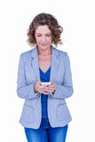 Businesswoman looking at her smartphone Royalty Free Stock Image