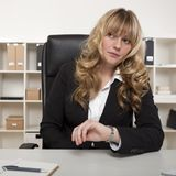 Businesswoman looking at her watch Stock Photo