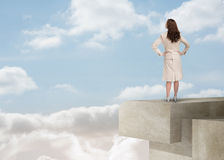 Businesswoman looking at the horizon over the clouds Royalty Free Stock Photos