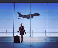 Businesswoman looking at jet Stock Image