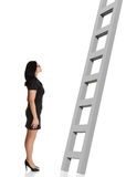Businesswoman looking at ladder. Stock Photo