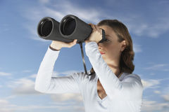 Businesswoman Looking Through Large Binoculars Royalty Free Stock Photography