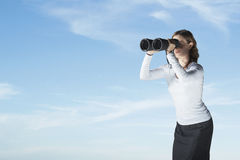 Businesswoman Looking Through Large Binoculars Stock Photo