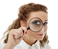 Businesswoman looking through a loupe Royalty Free Stock Photo