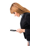 Businesswoman looking through magnifying glass Royalty Free Stock Images