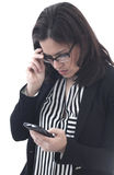 Businesswoman looking mobile phone Stock Photography