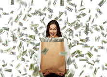 Businesswoman looking at money Royalty Free Stock Images