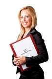 Businesswoman looking for a new job. Young businesswoman with a notepad and a curriculum vitae in her arms, looking for a job Stock Image