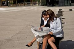Businesswoman looking at a newspaper Stock Photo