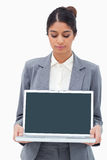 Businesswoman looking at notebook in her hands Royalty Free Stock Images
