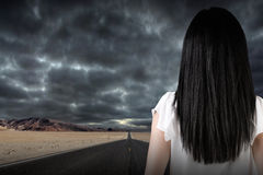 Free Businesswoman Looking Out A Dark Road Stock Photography - 79344032