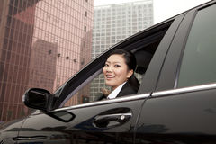 Businesswoman looking out car window Royalty Free Stock Photo