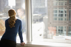 Free Businesswoman Looking Out Office Window Royalty Free Stock Photos - 8088978