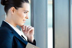 Businesswoman looking outside Stock Image