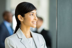 Businesswoman looking outside Stock Photography