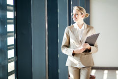 Businesswoman looking outside window Royalty Free Stock Image