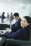 Businesswoman Looking Over Her Shoulder at the Camera Stock Images