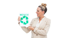 Businesswoman looking at recycling logo on paper Royalty Free Stock Photography
