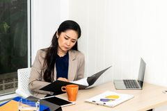 Businesswoman looking at report. royalty free stock photo