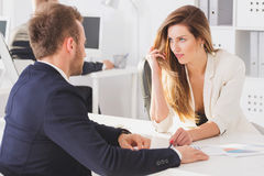 Businesswoman looking seductively at colleague Stock Photos