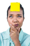 Businesswoman looking at the signe on her forehead Royalty Free Stock Photo