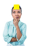 Businesswoman looking at the signe on her forehead Royalty Free Stock Image