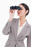 Businesswoman looking through spy glasses Royalty Free Stock Photos