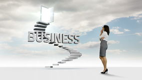 Businesswoman looking at steps with a floating word in the sky