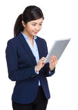 Businesswoman looking at tablet computer Stock Image