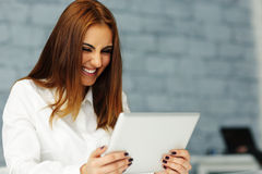 Businesswoman looking at tablet computer screen Royalty Free Stock Images