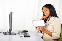 Businesswoman looking to a letter Stock Image