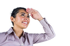 Businesswoman looking upwards with hands on head Royalty Free Stock Images