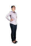 Businesswoman looking upwards with hands on hips Royalty Free Stock Image