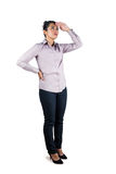 Businesswoman looking upwards with hands on hips Stock Photos