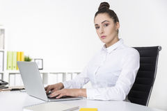 Businesswoman looking at the viewer with contempt Stock Photos