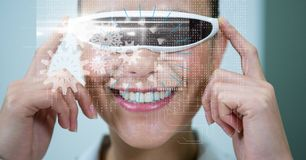 Businesswoman looking at virtual screen through VR glasses. Digital composite of Businesswoman looking at virtual screen through VR glasses Stock Photography