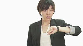 Businesswoman looking at watch, upset, annoyed stock video