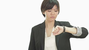 Businesswoman looking at watch, upset, annoyed stock video footage