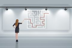 The businesswoman is looking for ways to escape from maze labyrinth. Businesswoman is looking for ways to escape from maze labyrinth Stock Photos
