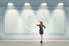 The businesswoman is looking for ways to escape from maze labyrinth. Businesswoman is looking for ways to escape from maze labyrinth Stock Image