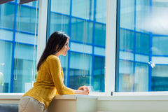 Businesswoman looking at window in office Royalty Free Stock Photos