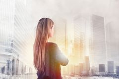 Businesswoman looks far for the future. Double exposure stock images