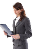 Businesswoman looks at the folder Royalty Free Stock Image