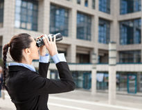 Businesswoman looks into the future Stock Image