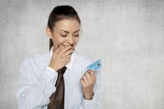 Businesswoman looks with great joy at the bank card Royalty Free Stock Photography